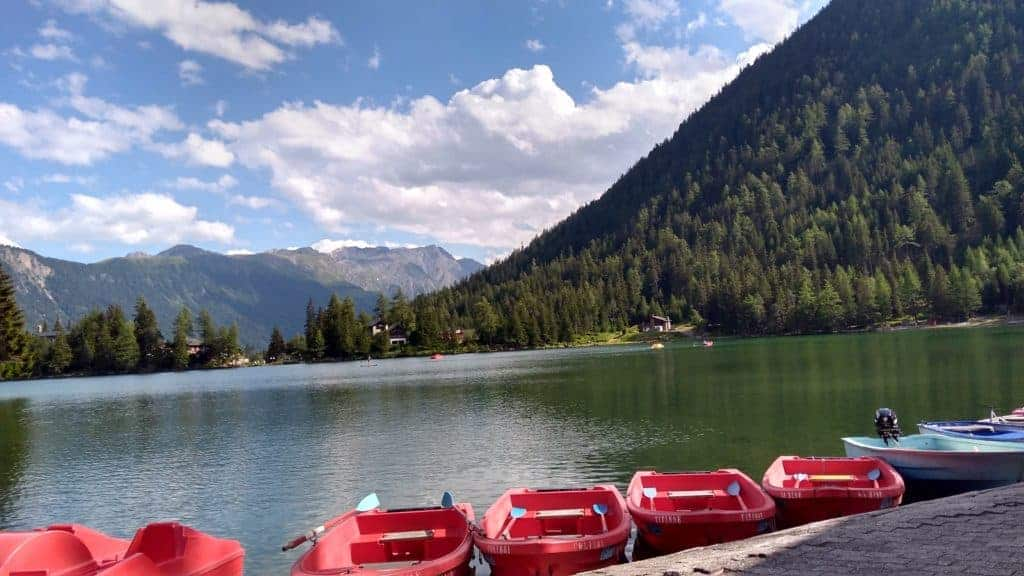 Red boats on the edge of Lac Champex, Tour du Mont Blanc