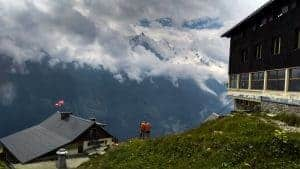 Hikers take in the view from Refuge la Flegere, TMB accommodation