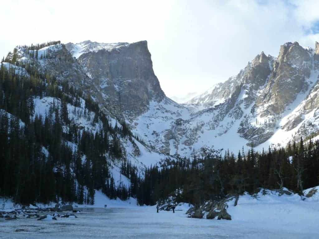 A frozen and snow covered Dream Lake, seen while snowshoeing in Rocky Mountain National Park