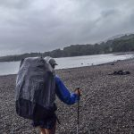 A hiker on the shores of Loch Lomond, West Highland Way