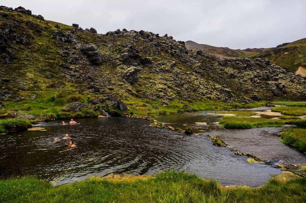 Hikers soaking in the hot springs at Landmannalaugar.