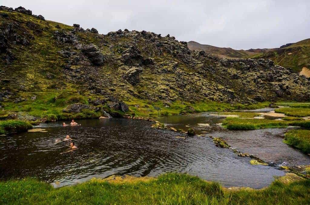 Hikers soaking in the hot springs at Landmannalaugar.