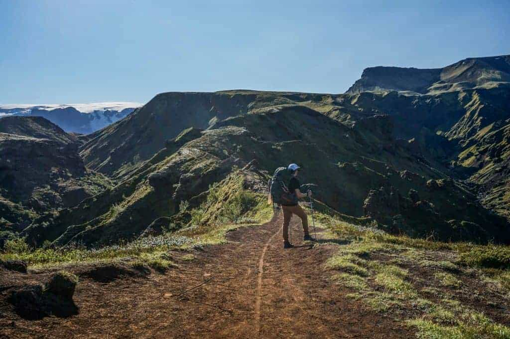 Hiker stands on a mountaintop on the Laugavegur Trail