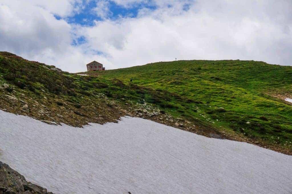 A large patch of snow below Refuge Col de Balme.