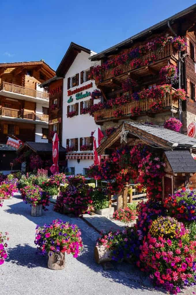 A hotel with flowerboxes in Arolla, Switzerland.
