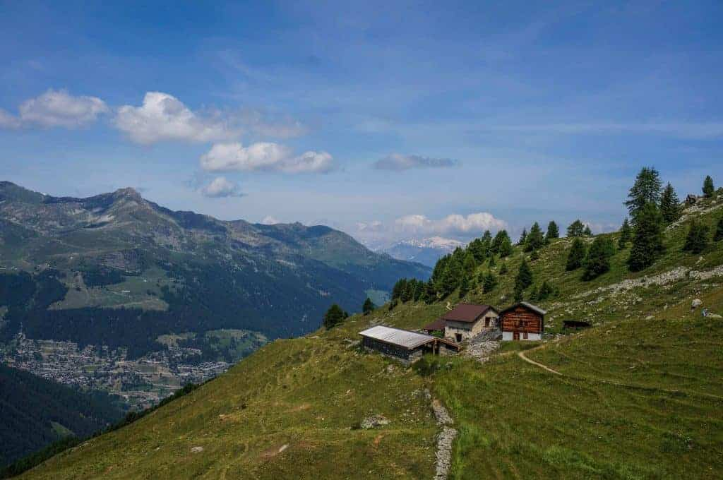 Overlooking a chalet and mountain views on the Walker's Haute Route