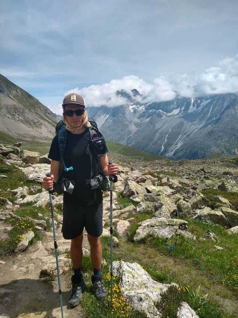 Hiker with trekking poles on the Walker's Haute Route