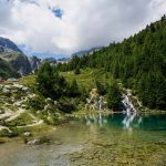 Cascades spill into Lac Bleu on the Walker's Haute Route