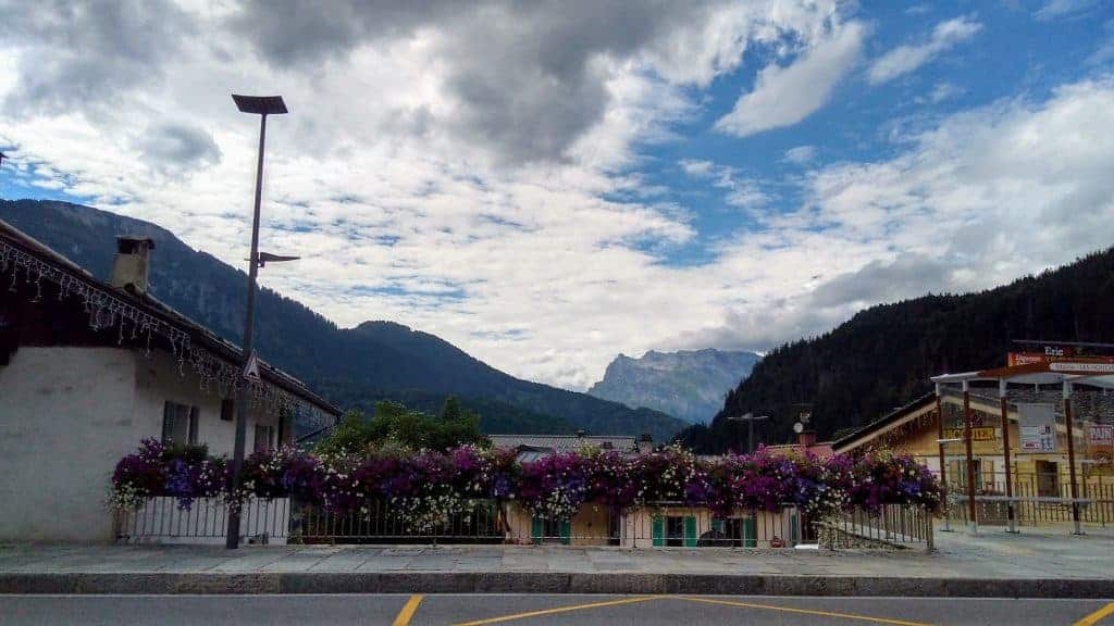 The bus stop in Les Houches, surrounded by pink flowers.