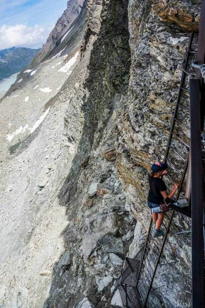 Climbing a ladder to reach the Pas des Chevres on Stage 7 of the Walker's Haute Route