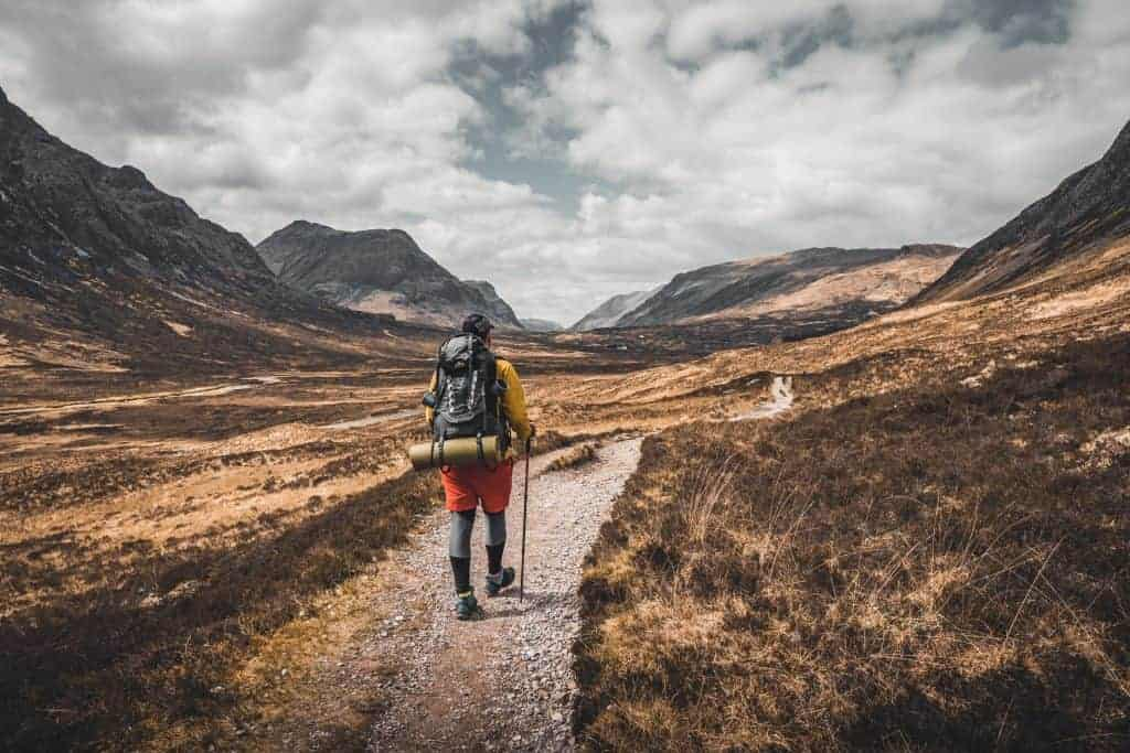 A backpacker walks along the West Highland Way