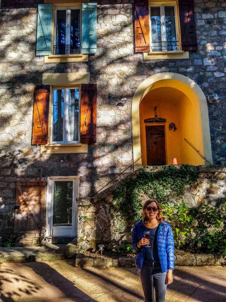 Woman with a glass of wine in front of Casa Alta B&B in Vizzavona Corsica