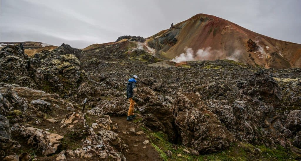 A hiker near a steam vent on Iceland's Laugavegur Trail