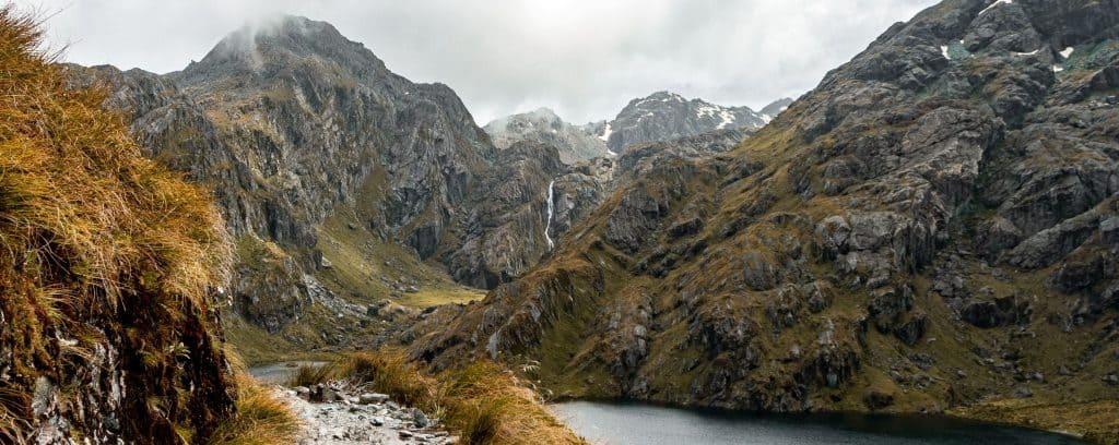 Hiking trail along Lake Harris on the Routeburn Track in New Zealand.