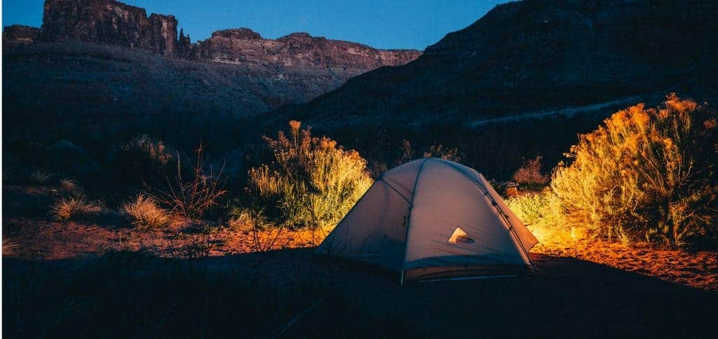Tent in Big Bend lite up at night.