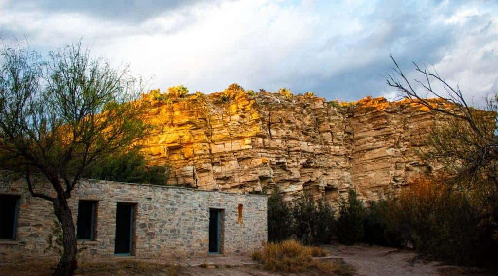 Stone building in front of bluff in Big Bend