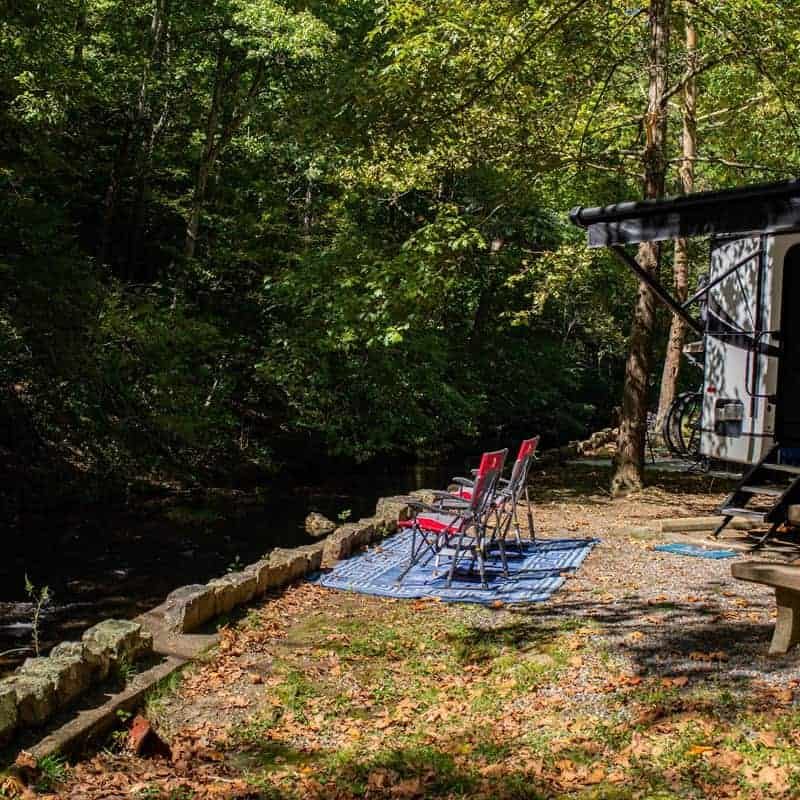 An RV parked by the stream at Gulpha Gorge Campground.