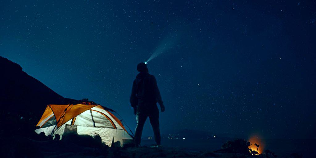 Camper with headlamp in Death Valley