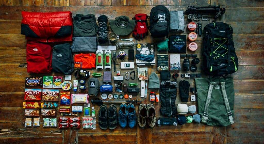 Hiking equipment laid out on the floor.