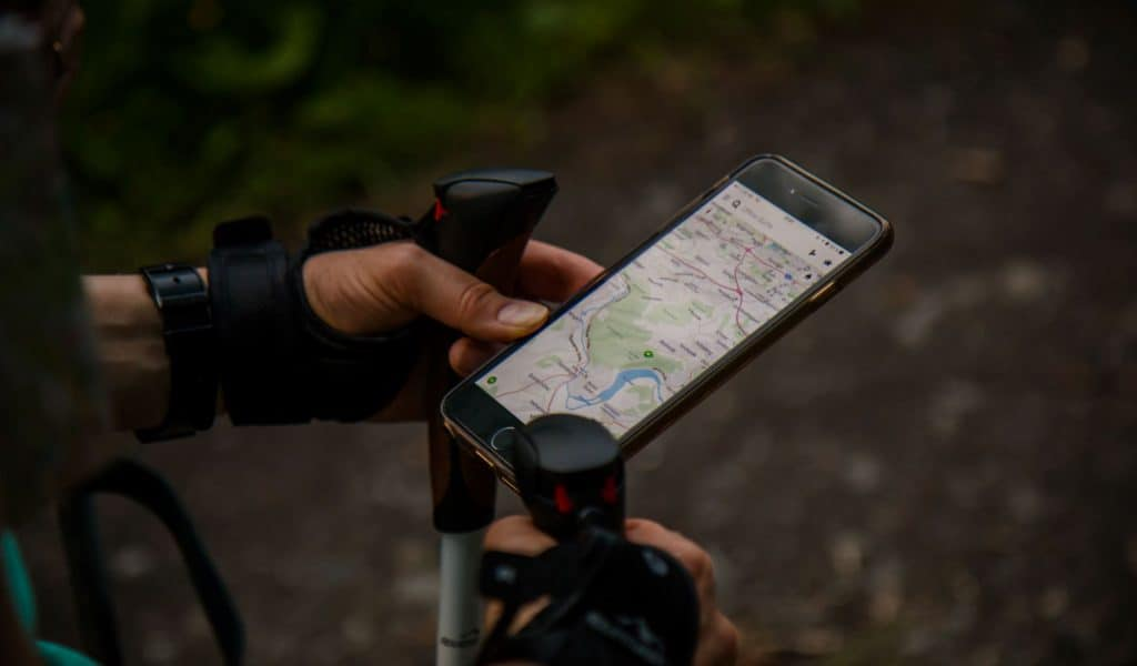Hiker with a map on their phone