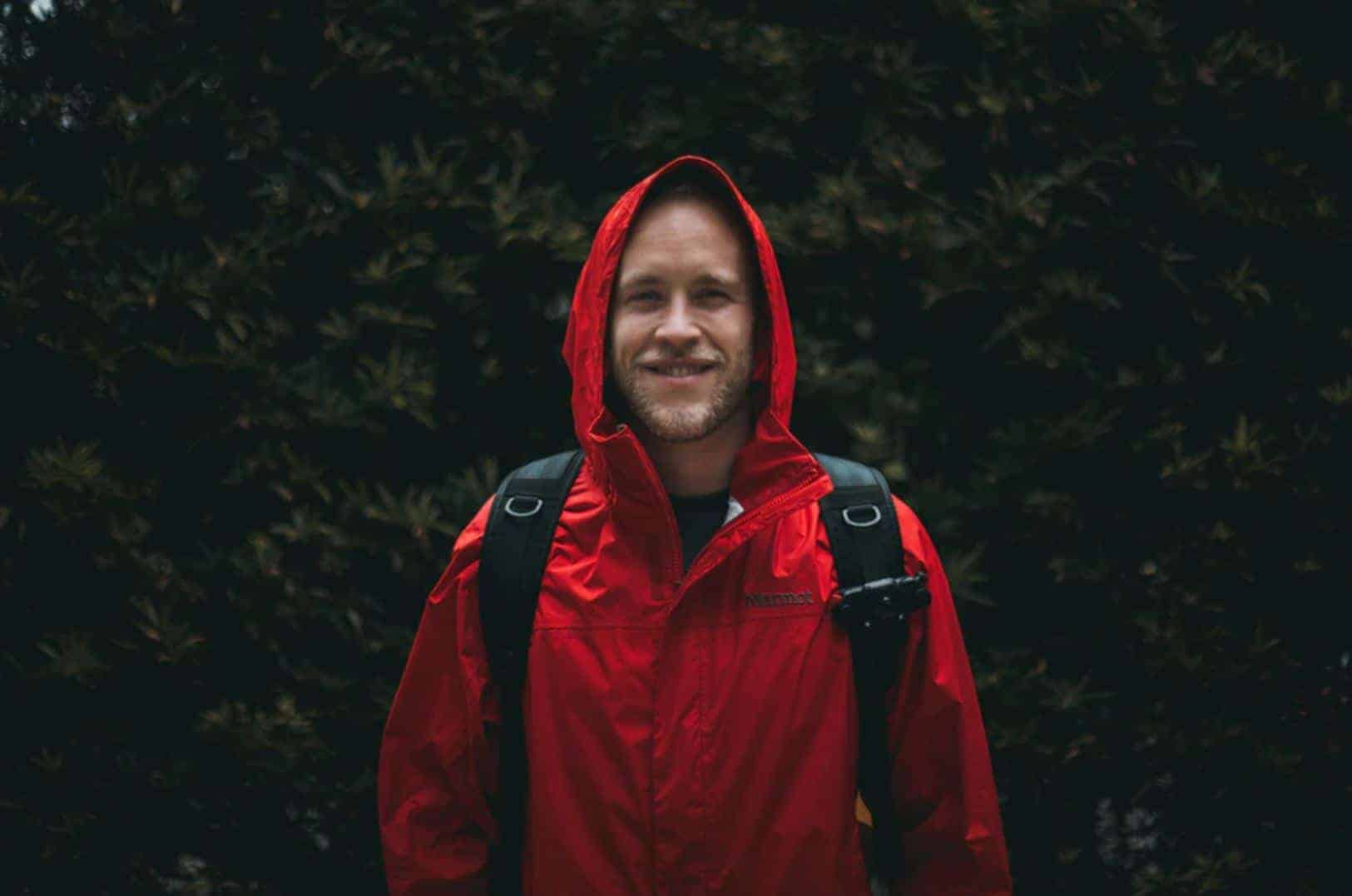Man standing in red rain jacket on the South Downs Way