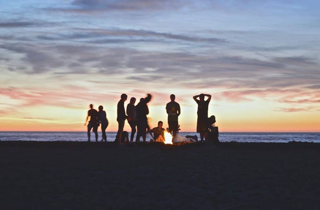 Silhouettes of people around a campfire on the beach at Lake Mead