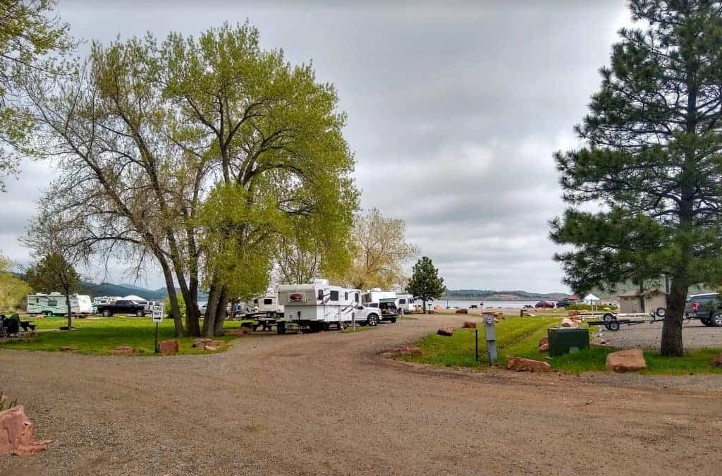 A dirt road and RVs parked at the South Shore Campground, Carter Lake