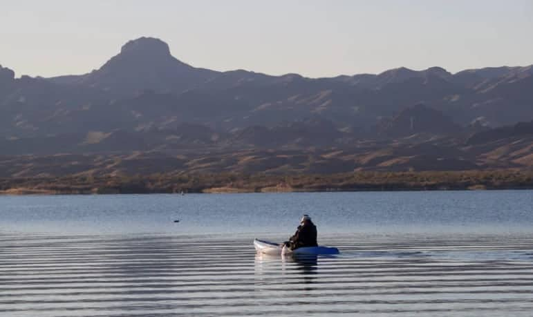 Kayak on the water with mountains in the background Lake Havasu