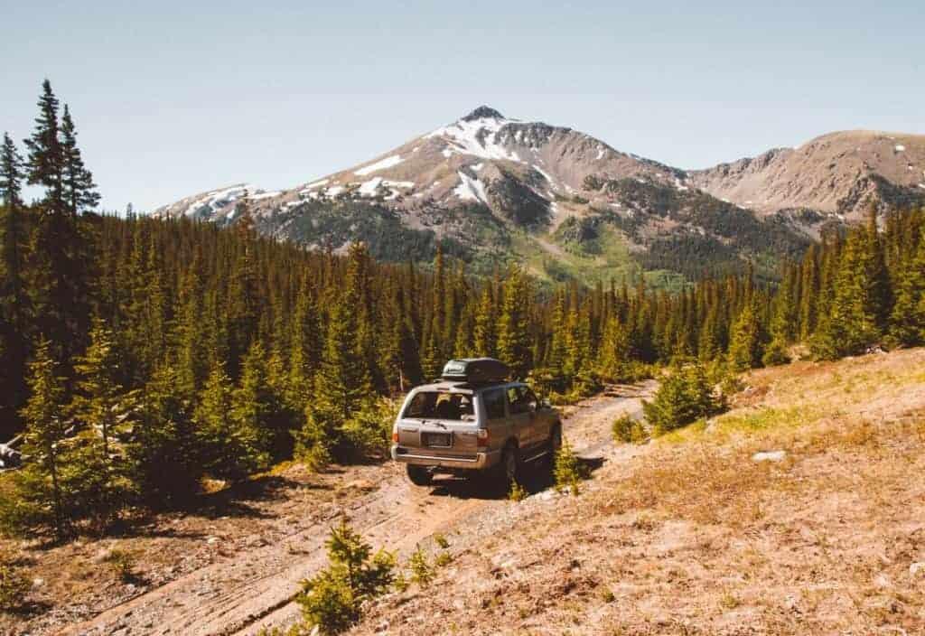 An suv drives on a dirt road near Buena Vista Colorado.