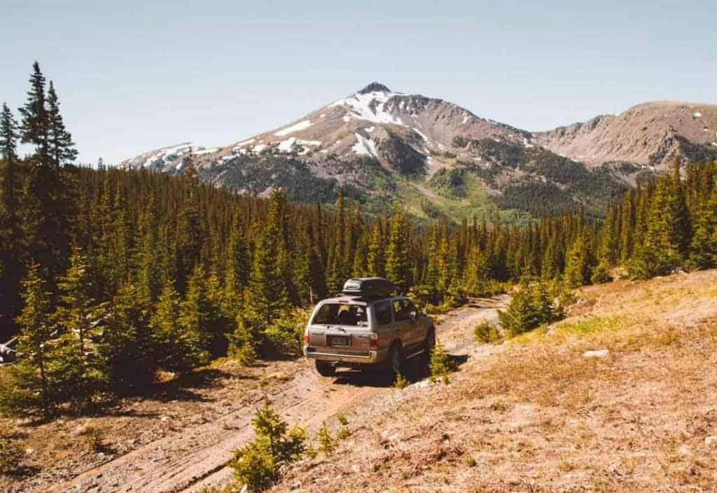 A car drives to Pearl Pass dispersed camping near Aspen