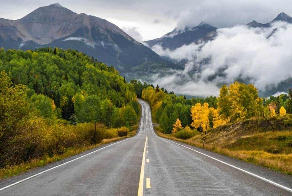 Road with mountains and fall colors in the background, Telluride, CO