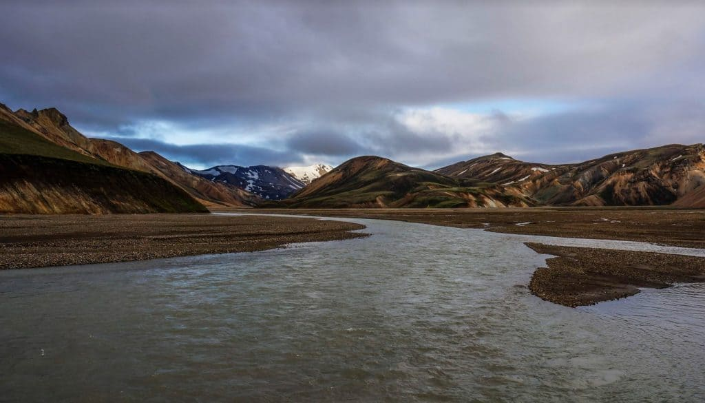 A river with mountains in the background on the first stage of the Laugavegur Trail.